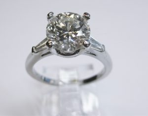 round and baguette 3 stone diamond ring