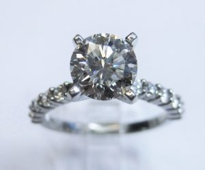 scalloped round diamond engagement ring